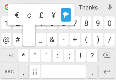 Peso sign on a mobile phone keyboard